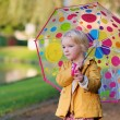Portrait of little girl with colourful umbrella — Stock Photo #55742963