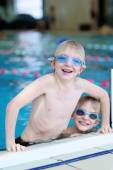 Two brothers having fun in swimming pool — Photo