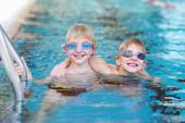 Two brothers having fun in swimming pool — Foto Stock