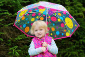 Portrait of little girl with colourful umbrella — Foto Stock