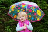 Portrait of little girl with colourful umbrella — Foto de Stock