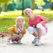 Brother and sister playing in the park — Stock Photo #56129757