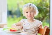 Little girl eating pasta for lunch — Stock Photo