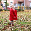 Little girl playing in autumn park — Stock Photo #57213501
