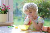 Toddler girl having breakfast at home — Foto de Stock