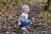 Preschooler girl having fun in the forest — Stock Photo
