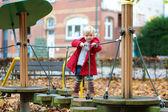 Little girl having fun at playground — Stock Photo