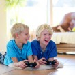 Two brothers playing video games at home — Stock Photo #58148759