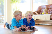 Two brothers playing video games at home — Stock Photo