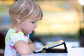 Little girl playing with tablet pc — Foto de Stock