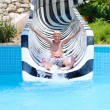 Happy boy sliding in waterpark — Stock fotografie #58950873