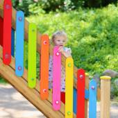 Little girl at colorful playground — Stock Photo