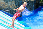 Happy boy in waterpark — Stock Photo