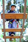 Adventurous boy climbing in the park — Stock Photo