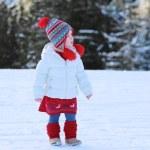 Little girl in Alpine resort at winter — Stock Photo #59308363