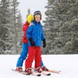 Two happy boys skiing in the Alps — Stock Photo #59309597