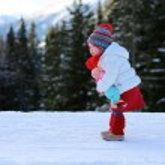 Little girl in Alpine resort at winter — Stock Photo #59309603