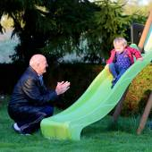 Grandfather and granddaughter in playground — Stock Photo