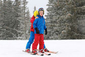 Two happy boys skiing in the Alps — Stock Photo