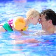 Father and daughter swimming in pool — Stock Photo #59470671