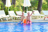 Two brothers in swimming pool — Stok fotoğraf