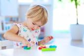 Preschooler girl playing with plasticine — Stock Photo