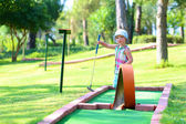 Little girl playing mini golf outdoors — Stock Photo