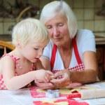 Grandma with granddaughter preparing cookies — Stock Photo #60507783