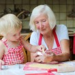 Grandma with granddaughter preparing cookies — Stock Photo #60507791