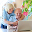 Modern senior couple relaxing at home — Stock Photo #62561441