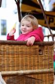 Happy girl enjoying merry-go-round — Stock Photo