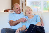 Modern senior couple relaxing at home — Stock Photo