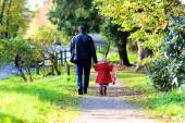 Father with little daughter walking together in the park — Stock Photo
