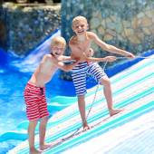 Two brothers having fun at aqua park — Stock Photo