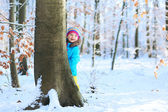 Little girl playing at winter forest — Stock Photo