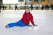 Happy school boy having fun at ice skating rink — Stock Photo
