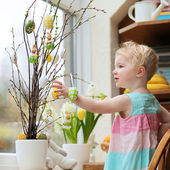 Little girl decoration home for Easter — Stock Photo