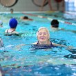 Постер, плакат: Active senior woman swimming in the pool