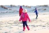 Group of kids playing at winter on the beach — Stock Photo
