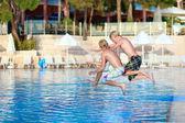 Two happy boys having fun in swimming pool — Stock Photo