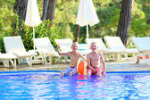Two happy boys having fun in swimming pool — Foto de Stock