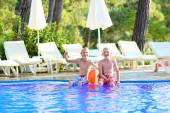 Two happy boys having fun in swimming pool — Stockfoto