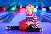 Little girl enjoying bowling — Stock Photo