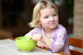 Blonde little girl eating muesli with yoghurt for breakfast — Foto Stock