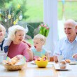 Grandparents with grandchildren enjoying Easter breakfast — Stock Photo #64861697