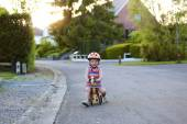 Little girl riding tricycle on the street — 图库照片