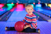 Little girl playing bowling — Stock Photo