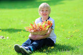 Happy school boy holding basket with easter eggs — Stok fotoğraf