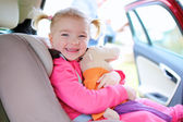 Happy toddler girl enjoying trip in the car — Stock Photo