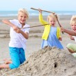 Happy kids playing on the beach — Stock Photo #68115471
